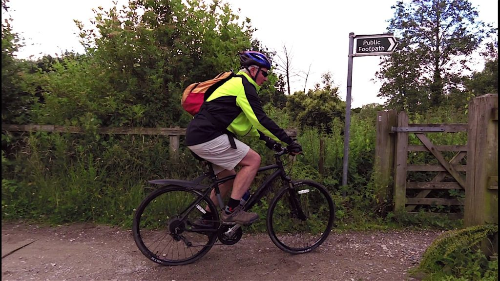 John giving his new steed a run out, seconds before dismounting for the footpath obviously!